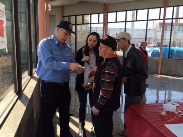 Volunteers presented fire safety demonstrations including battery installation for smoke detectors.