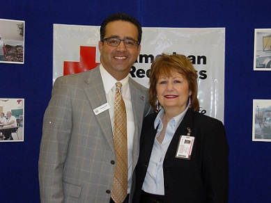 """Lorain County Chapter Executive, Rita Campbell stands with Lorain County Chamber of Commerce President, Tony Gallo, during the March """"Coffee, Tea and Contacts"""" networking event held at the chapter."""