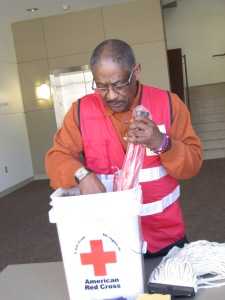 Summit and Portage County Board Member, Leonard Foster, loads a clean-up kit at the chapter.