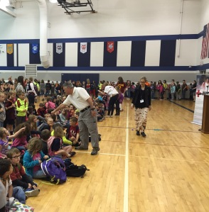 Tim Reichel fist bumps a Fairless Elementary student.