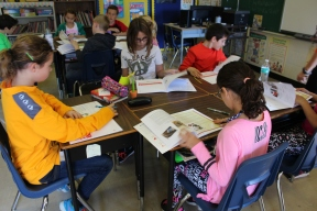 Students review information in booklets they are given to keep