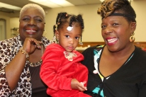 Volunteer Arie Freeman, left, with great-granddaughter Genesis Boles and daughter Tracey Mackey