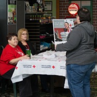 A customer receives Red Cross information