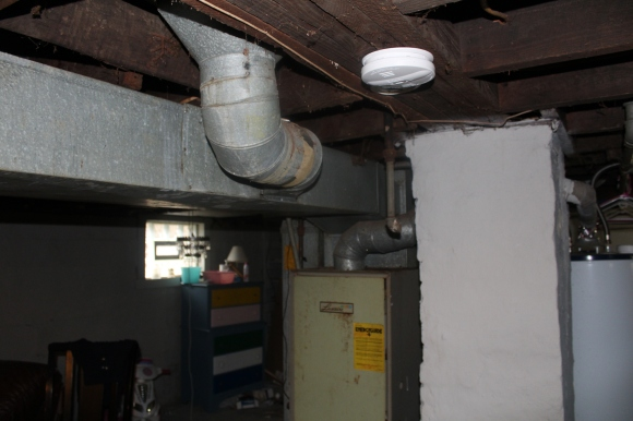 Basement furnace in proximity to smoke alarm