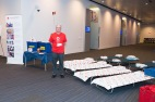 Volunteer with cots
