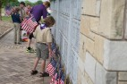 Scouts decorate the Ohio Western Reserve National Cemetery with U. S. flags for the 2016 Memorial Day Ceremony: Photo credit/Cal Pusateri, American Red Cross Volunteer