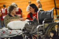 """June 26, 2016. Charleston, West Virginia. Floods. Lucille Chandler speaks with American Red Cross staff Joanna King. 90-year-old Lucille Chandler's home in Clendenin was flooded on Thursday. She and her daughter were rescued by a neighbor who had a boat. He transported them to a nearby church that was partially flooded, but where the top floor was still dry and used by local residents seeking shelter. Yesterday she was brought to the Capital High School gymnasium in Charleston which has been turned into an Red Cross shelter. """"I really appreciate what the Red Cross has done for me,"""" explains Lucille, """"I have a problem walking and the Red Cross volunteers bring me around in a wheelchair"""". The next step for Lucille's Red Cross assistance will be handled by caseworkers. Photo by Daniel Cima for the American Red Cross"""