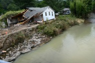 June 27, 2016. West Virginia. Floods. A house in White Sulfur Springs damaged by flooding when Howard Creek broke its banks on June 23, 2016, following severe rains. Photos by Daniel Cima for the American Red Cross