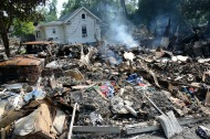 June 27, 2016. West Virginia. Floods. What remains of three homes that burned to the ground when they were flooded in White Sulfur Springs. In one of the homes a resident died. Photos by Daniel Cima for the American Red Cross