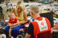 June 26, 2016. Charleston, West Virginia. Floods. Heather Shafer and her one-year-old daughter Sarah lives with her parents in East Clendenin. Their home was flooded and they now staying at the Capital High School gymnasium in Charleston which has been turned into a Red Cross shelter. Photo by Daniel Cima for the American Red Cross