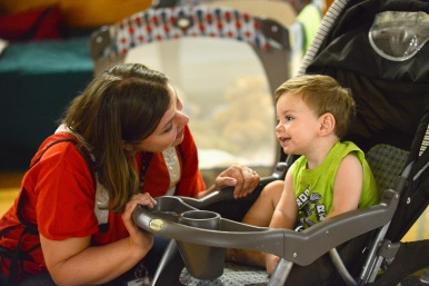 June 29, 2016. Charleston, West Virginia. Red Cross employee Mary Williams with 18-month-old Liam Parker who, along with his mother and father, is a flood victim from Clendenin, West Virginia. He and his family are staying at Capital High School gymnasium in Charleston, which has been turned into a Red Cross shelter. Photo by Daniel Cima for the American Red Cross