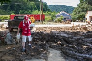 June 30, 2016. Birch River, West Virginia. American Red Cross worker Kevin Beale delivers containers of pulled pork to a Birch River, West Virginia, resident. The emergency response vehicle traveled through neighborhoods, delivering nearly 150 hot meals to the community. Photo by Marko Kokic for the American Red Cross