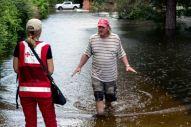 August 16, 2016. Gonzales, Louisiana. David Moore in a flooded neighborhood. Photo by: Marko Kokic/American Red Cross