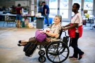 "August 16, 2016. Gonzales, Louisiana. Sharon Butler-Walker is a new Red Cross volunteer, who is inspired to help others because ""she loves helping"" and she says there's a great need for volunteers. She brought Glenda Hill to her temporary lodging at the Red Cross shelter in Gonzales, Louisiana. Photo by: Marko Kokic/American Red Cross"