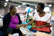 """August 16, 2016. Gonzales, Louisiana. Redina Lee talks with Sharon Butler-Walker, a new Red Cross volunteer. Redina says the Red Cross shelter has been good. """"I'm blessed here. I don't have to pay anything."""" Redina is staying at the Red Cross shelter in Gonzales, Louisiana. Photo by: Marko Kokic/American Red Cross"""