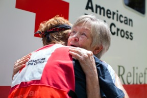 "August 18, 2016. Denham Springs, Louisiana. Tears fill Fonda's eyes as she ran, arms opens, from her flooded Louisiana home. Her first request? ""I want a hug,"" says Fonda Buckley as she embraces Red Cross volunteer Cora Lee. Photo by: Marko Kokic/American Red Cross"