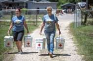 August 19, 2016. Denham, Louisiana. Project Homecoming relief workers Karin Peri-Ramos (l) and Christina Drake (r) deliver Red Cross clean-up kits to families beginning to recover from the flooding in southern Louisiana Photo by: Marko Kokic/American Red Cross