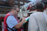 Greater Cleveland Chapter Disaster Program Manager Jeremy Bayer offers help to a resident