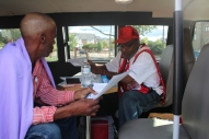 Resident Therens Vitanzan receives assistance from Red Cross volunteer Walter Reddick
