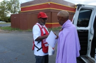 Red Cross volunteer Walter Reddick and client Therens Vitanzan