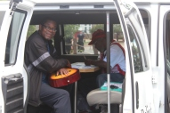 Red Cross client Larry Anderson receives assistance from Red Cross volunteer Walter Reddick