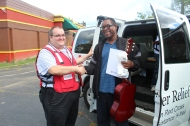 Red Cross Disaster Program Manager Jeremy Bayer and client Larry Anderson