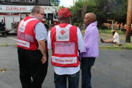 Red Cross Disaster Program Manager Jeremy Bayer, volunteer Walter Reddick and client Therens Vitanzan