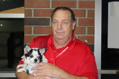 Red Cross Volunteer Pat Kern holds Lila, the pet of a shelter resident