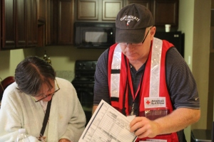 north-olmsted-ohio-resident-christine-kisela-assisted-by-red-cross-volunteer-gary-grano