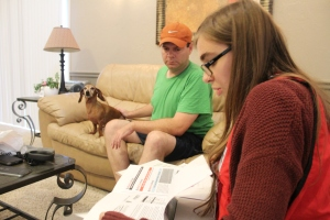 red-cross-volunteer-taylor-ley-assists-north-olmsted-ohhio-resident-keith-kasprzyk