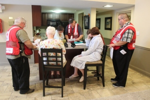 red-cross-volunteers-mark-cline-and-gary-grano-and-disaster-program-manager-jeremy-bayer-assist-clients-in-north-olmsted