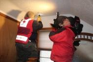 WJW Photographer Jim Pijor records John Gareis installing a smoke alarm