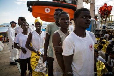 Migrants get ready to disembark from the Responder ship -- after being rescued from the Mediterranean Sea. Photo credit: Mathieu Willcocks/MOAS