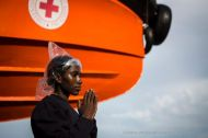 A migrant aboard the Responder ship prays after being rescued from a rubber dinghy in the Mediterranean Sea. Photo credit: Mathieu Willcocks/MOAS