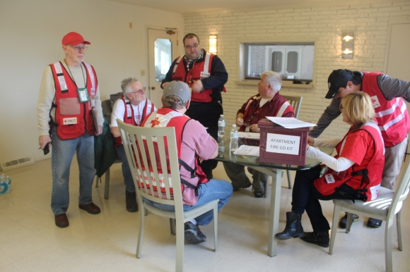 Red Cross disaster workers strategize after responding to the fire at the North Randall Estates