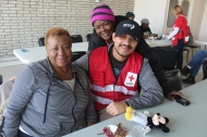 North Randall residents Bobbie Thrower, left, and Beverly Thomas, behind Red Cross volunteer disaster worker Eric Reyes
