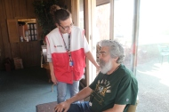 Red Cross Disaster Relief volunteer Teresa Greenlief offers comfort to Cuyahoga Falls resident Robert Loch.