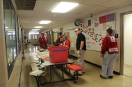 Red Cross shelter workers setting up a shelter for Cuyahoga Falls residents inside a local school building