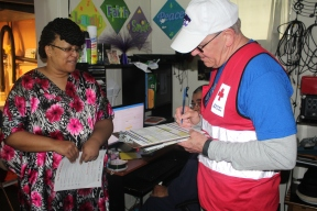 Maple Heights resident Mikoyan Headen receives fire safety information from Red Cross volunteer Bill Renninger of Team Rubicon