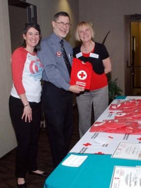 Pat poses with colleague Debra Kellar and volunteer Paul Wadowick