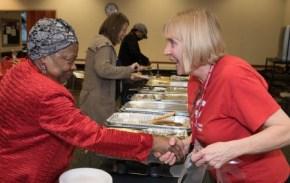 Pat greets a volunteer
