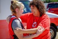 September 7, 2017. Sugar Land, Texas. Red Cross volunteers Julie Fox, left and Diana Ochsner reacts to Julie going to adopt the dog that a Hurricane Harvey victim had to leave behind. Photo by Chuck Haupt for the American Red Cross