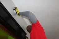 KeyBank employee Jamil Sanders installs a smoke alarm