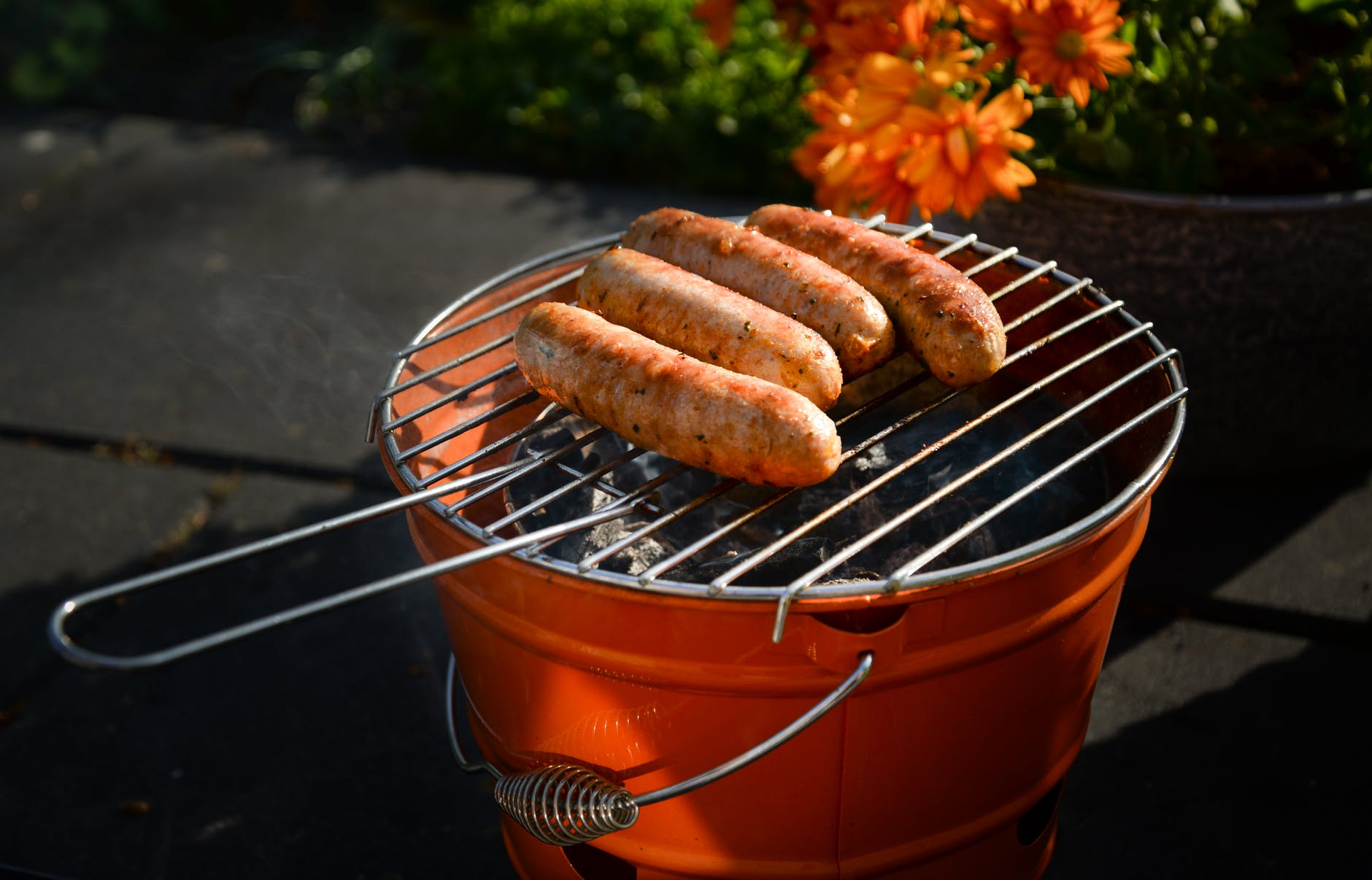 charcoal grill with sausage