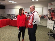 Greater Cleveland board member Matt Garrity takes a moment during the telethon to speak with Natalie Herbick
