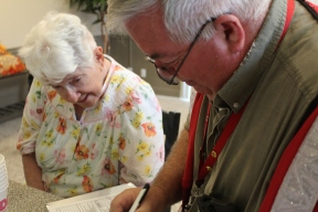 North Olmsted, Ohio resident Joan Kravets assisted by Red Cross volunteer Mark Cline