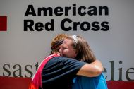 August 18, 2016. Denham Springs, Louisiana. During a hot meal distribution in southern Louisiana, Red Cross volunteer Cora Lee, a local relief worker from Baton Rouge, hugs her daughter Shannon Lee, whose home was flooded in Denham Springs. Photo by: Marko Kokic/American Red Cross