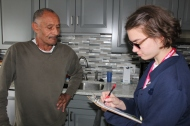 Virginia Hexter shares fire safety information with Bedford Heights resident Charles Stuckey