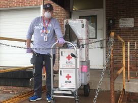 May 19, 2020. Columbus, Ohio. Rich Tawny, Red Cross volunteer driver, moves boxes of blood products to prepare for delivery to patients in need at hospitals. Photo by Craig Miller/American Red Cross