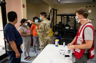 July 28, 2020. Edcouch, Texas The Cantu's family get their temperatures checked as part of a COVID-19 screening precaution before entering a Red Cross emergency shelter for people displaced by Hurricane Hanna in Edcouch, TX on Tuesday July 28, 2020. Photo by Scott Dalton/American Red Cross